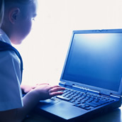 computing - a child working on a laptop