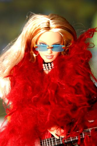 Barbie in an amusing red outfit - Yup, It's the ever fashionable, sexy, dazzling, elegantly crafted doll- Barbie!