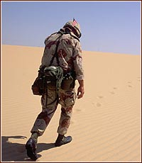 Soldier - A soldier in the sand, between a war in iraq.