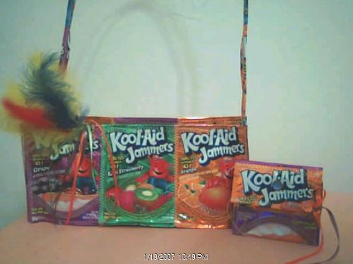 koolaid jammers with feathers - I just felt bored and made this bag. What is the going price? I don't know you tell me.