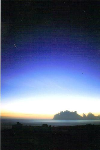 Twilight at La Push, Washington - This photograph was taken while camped on the beach on Washington's Olmpic Coastline in 2004.  The coolest part about this photo is that I placed the camera on a tripod and left the shutter open for a whole 5 minutes.  It was nearly dark and you can see the movement of a star within those five minutes.