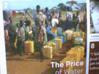 people fetching water - This photo shows the African people are fetching water at the watertap.