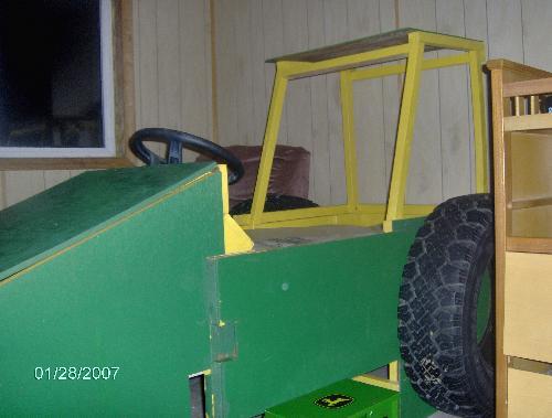 My grandson's tractor bed - My grandson's tractor bed that my boyfriend made.