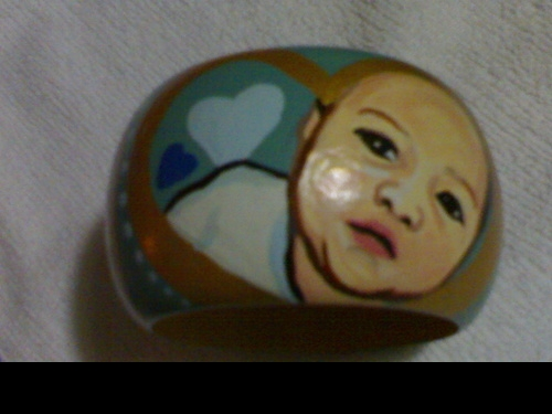 son photo in a bangle - chic personalized bangle. this one is the photo of my friend's son. :)