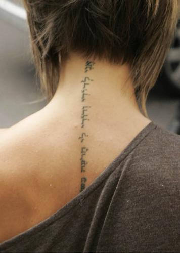 victoria beckham tattoo on neck. Victoria Beckham tattoo