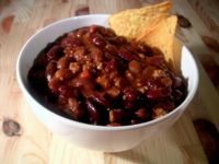 Chili - a bowl of chili con carn with a tortilla chip garnish.