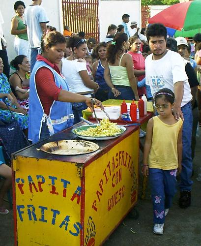 A street vendor selling French Fries in Nicaragua - This is a photo of a street vendor selling french fries in Nicaragua