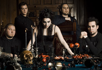Darker Amy Lee - This photo was sent to me by a friend. It shows Amy Lee darker than usual with her bandmates in the background at a beautifully gothic dinner table.