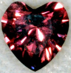 why you love someone???? - this is a heart shaped RED DIAMOND. it is natural, fancy,intense,purplish n red. it costs $149,108 per carat...