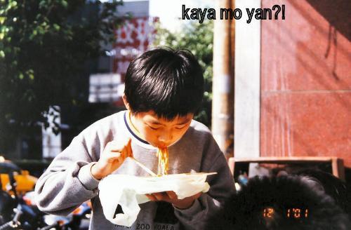 chopsticks - a kid eating noodles using chopsticks.