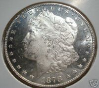 Silver Morgan Dollar - 1878S Silver Morgan Dollar. She's a beauty. Right now the auctions that closely looks like her that are ending on ebay are selling her for between $51- $79 not bad since I only paid two dollars for her at a small county auction.
