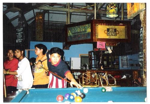 on a rare occasion that i went out with friends - this is me playing billiards in the island of boracay, philippines