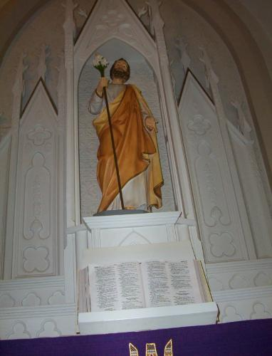 St. Joseph - Bible - the St. Joseph Catholic Bible open under the statue of St. Joseph at St. Theresa Church Shiefield Ohio