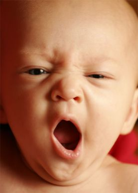 Are you yawning now? - Picture of baby yawning.