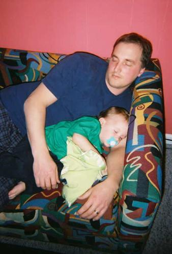 a man sleeping with his child - a man sleeping with his child, it is make parents so happy if theire children sleep with them.