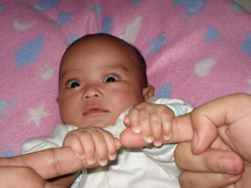 Nice hand grip. - Our baby with a nice, tight grip on daddy and mommy's hands.