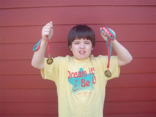 Two-time Gold Medalist! - We are so proud of our son and he's ecstatic as well for winning two, count them, two Gold Medals in Special Olympics - 'individual basketball skills' competitions. He won his first one in January at Regional competition and his second one at State competition in March (St. Patrick's Day), 2007. He's going to be in our local paper (all of about 8 pages; our paper is very small...lol) next week..!