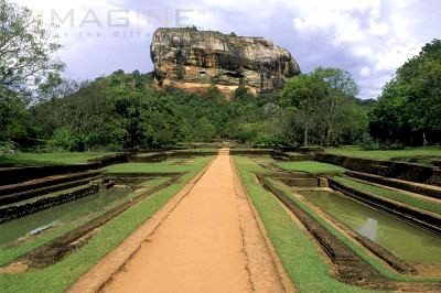 sri lanka - this is the mount sigiriya. it is where the old castle was built a hundred years ago. it is almost 2400 feet high. you can climb this easily because the people built stairs for easy climbing. most of the tourists do climb this mountain.