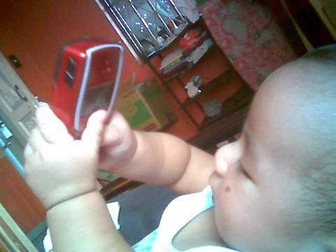 my baby playing with cellphone - look at this, he is so adorable and cute!