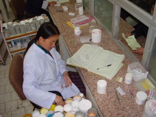 Medicine - Pharmacy technician sorting out the medicine