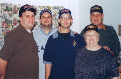 Our boys in 9/11 Firemen and Police hats Dec 2001 - This last couple of days have had me crying at the drop of a hat.