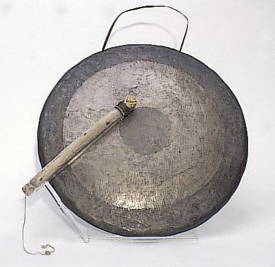 The gong - A picture of a gong and its stick.