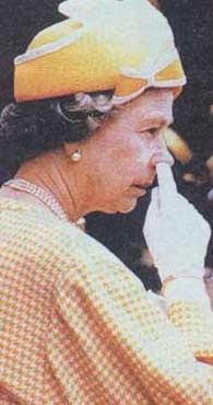 Queen of Nose Picking - The queen of England picks her nose.