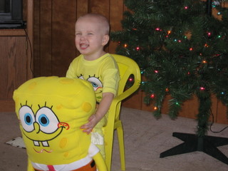 SpongeBob SquarePants Fanatic - My son, Christmas 2006, new SpongeBob stuffed toy, pajamas, chair, in front of the Christmas tree.