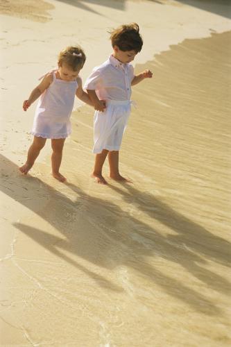 shadows - children looking at their shadows