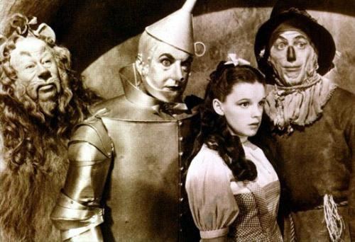 All Four - Black and white image of Dorothy, Tinman, Scarecrow, and the Cowardly lion from The Wizard of Oz