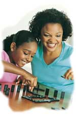 Mother Child - Mother and her daughter playing together. They are playing a board game and having fun. They're smiling and laughing, enjoying each other's company.