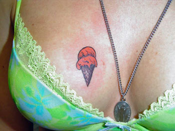 Ice Cream Tatto - A girl with an ice cream cone tattooed on her chest.