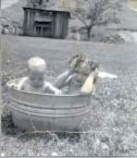 Bathing In a Galvanized Tub - image showing children playing/bathing in a galvanized tub just like in the old days when some people had no indoor plumbing.
