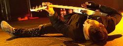 Frank Iero Laying Down. - Frank Iero laying down. xD but he's playing his guitar. I should be sleeping. Maybe dreaming of playing my bass?