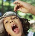 Earthworm : good for health - Boy eating an earthworm