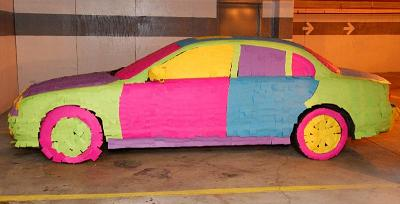 car covered with sticky notes  - how many do you think there is?