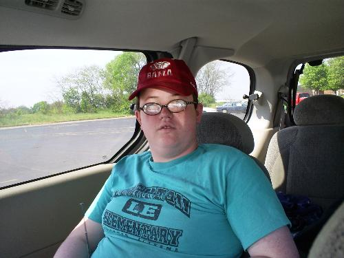 My son Stuart - He was sitting in our car when I took this picture.