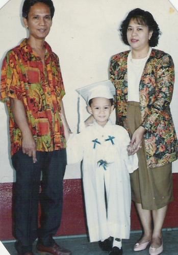 Graduation Nursery - This is my family during my son's graduation in nursery. We were so proud of him coming up as a Valedictorian. He even delivered a speech. Everytime I look at this picture, I cannot help but smile, coz God smiled at us when He gave this boy to us after 8 years of marriage.