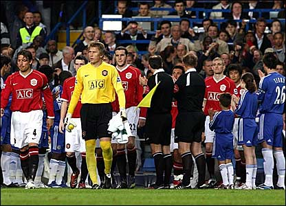 Guard Of Honour - Chelsea players lined up to form a guard of honour to the newly crowned premiership champions