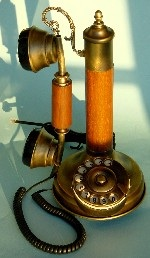 telephone - It is an old candlestick telephone.