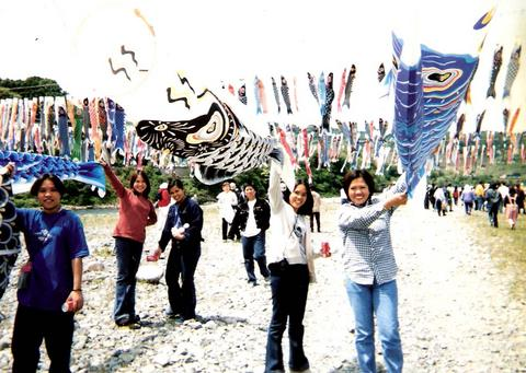 hanging fish kites - having fun decorating fish kites on the riverside...