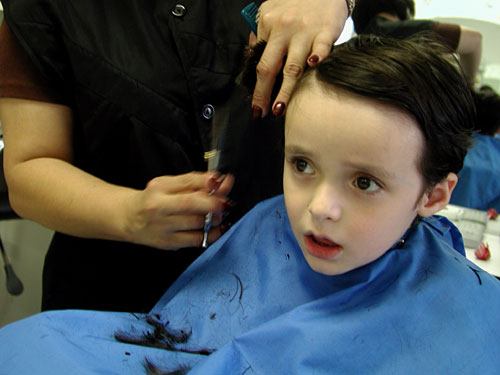 how much you shell out for doing this?? - A kid having his first haircut!