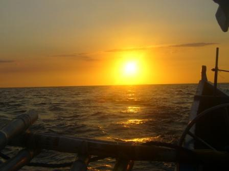 the sea, the banca and the setting sun - This was taken by my bestfriend in my primary years. I just love how the sea, the banca and the setting sun were put together in a picture.
