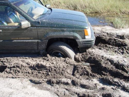 Close up of my jeep stuck - This shows how deeply my wheels dug into the slick mud.