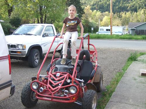 Courtney on the Go-Kart - This is my youngest on the go-kart. She's so tricky.