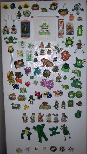 a magnet collection - The owner of this fridge obviously collects frogs! at least the magnetic variety. I think it looks pretty neat, and tidy! wonder if there are any princes amongst them.