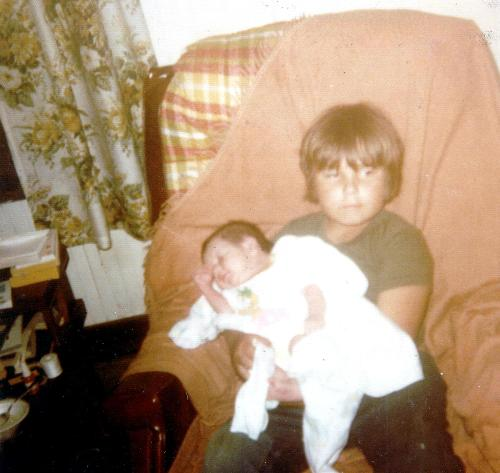 My son thirty years ago - My son Jimmy the day he came home from the hospital and his cousin Shawn. You can see he is thrilled to be holding the baby.