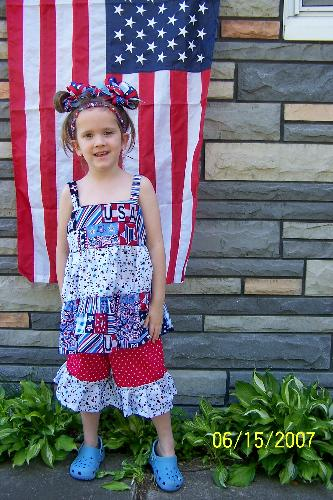 5yr. old daughter in a Patriotic outfit I just com - An outfit I just finished, complete w/hair accessories. It's a 5T, possibly even to fit an average 6 yr. old. Great outfit and bows. The bows are even great for school uniforms if they're the right colors. Check it out on eBay (6/15 - 16/20/07). Search: Boutique FAD.