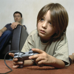 Child addicted to game? - Child playing a video game