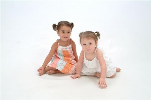 Sena and her cousin Devin - We had these pictures done today at Portrait Innovations. Sena wasn't in a very good mood after waiting till our turn.